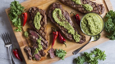 Grilled Strip Loin Steaks with Kale Chimichurri Sauce