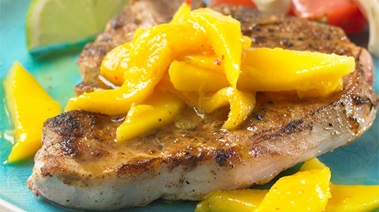 Grilled Pork Chops topped with Rum-spiked Mangoes