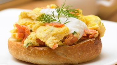Scrambled Eggs with Smoked Salmon on a Bagel